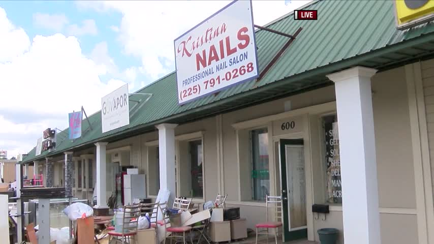 Local Businesses Clean Up After Flood_68814767-159532