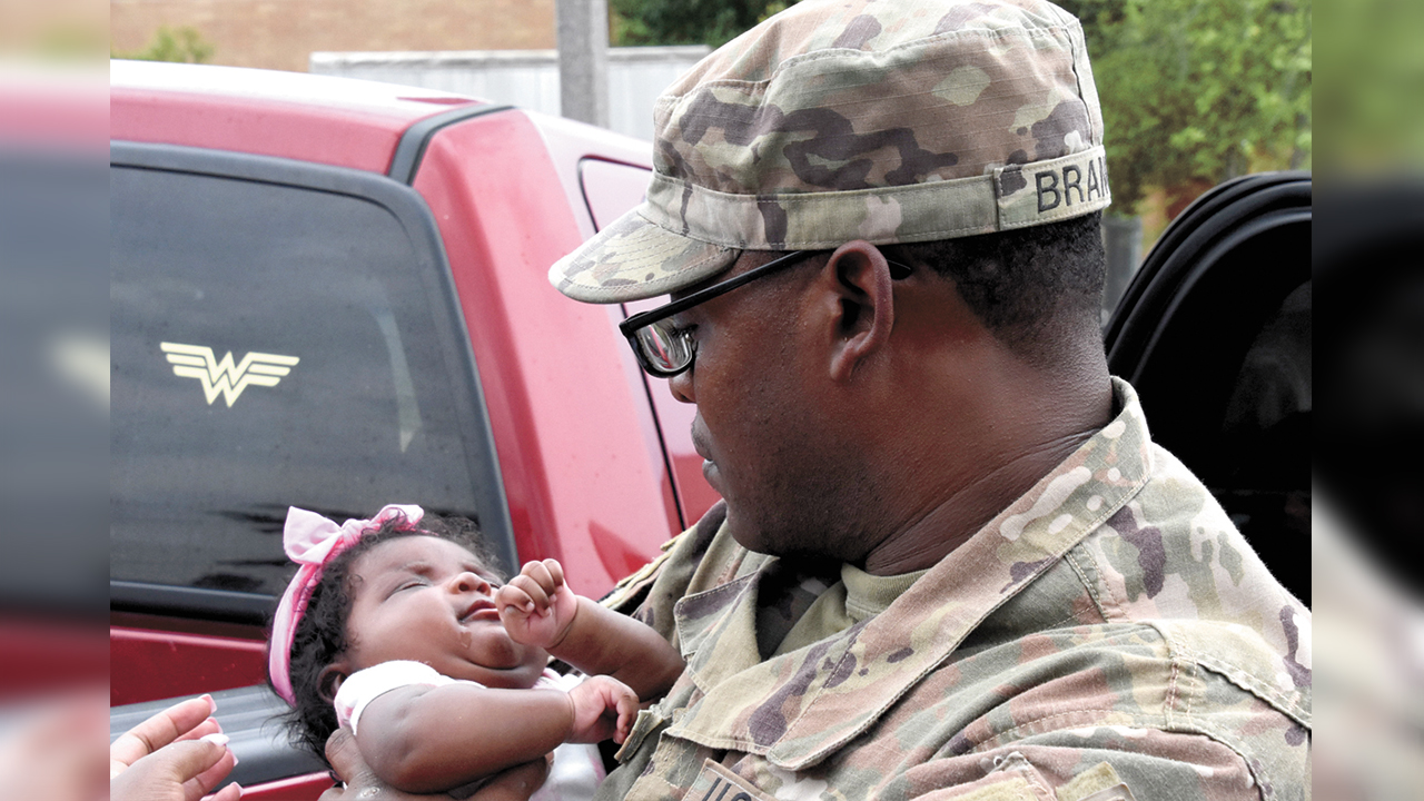 Returning soldiers greeted by family and friends at Fort Polk