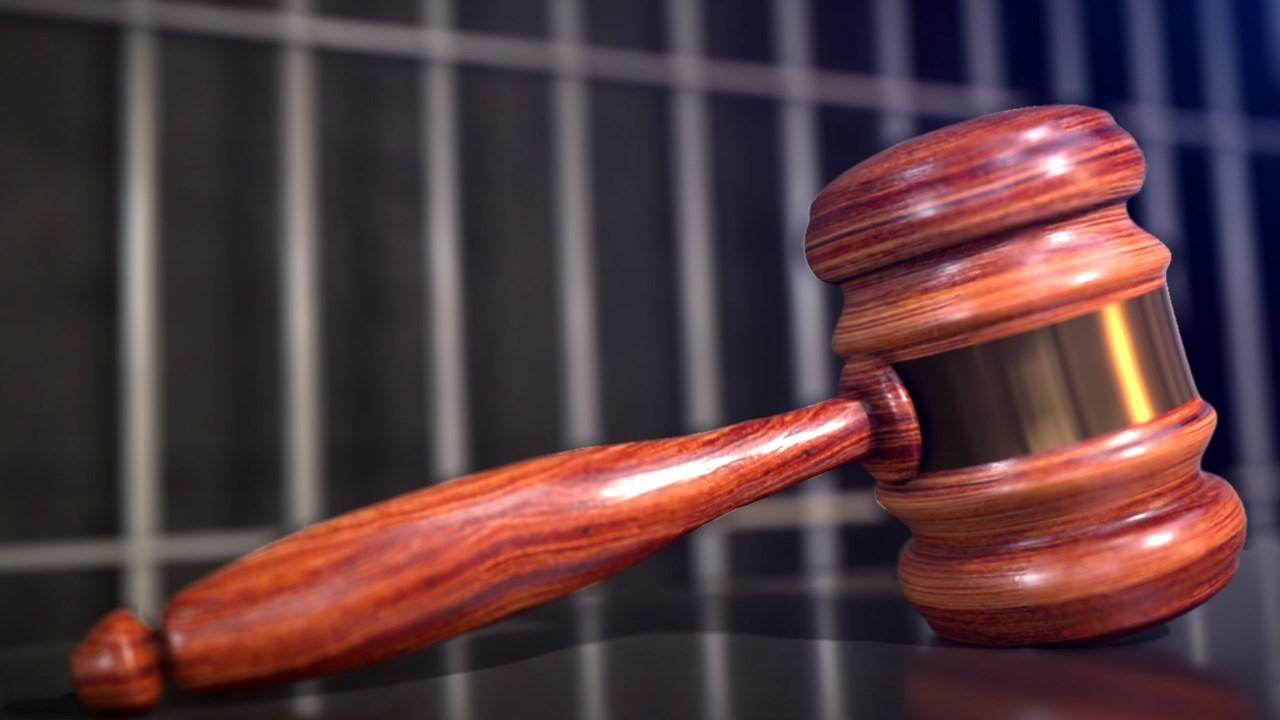 gavel and jail bars-842162556