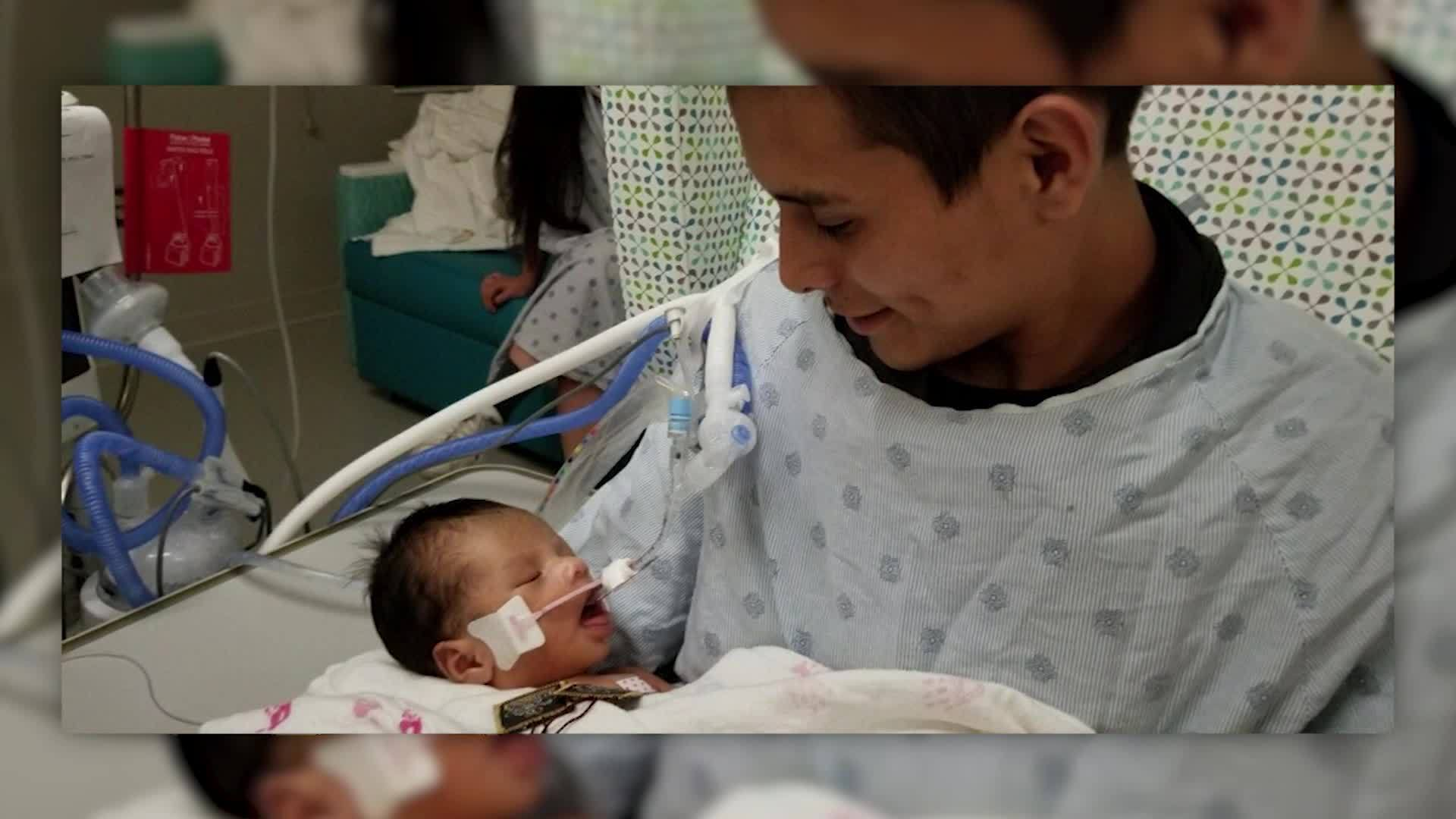 Father_holds_baby_cut_from_missing_teen__6_20190521122628-846653543