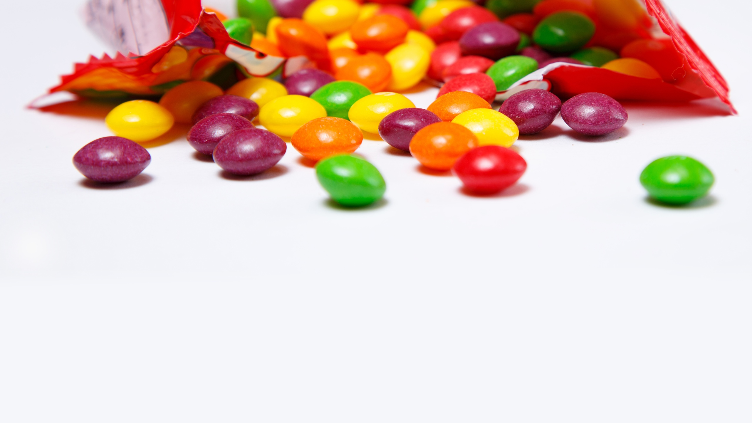 Openned pack with skittles in it_1560461968751