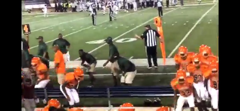 NEW VIDEO: Fans, players run for cover during football game